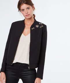 Veste chic empiècements strass noir.