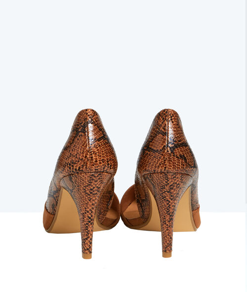 Pumps in twee materialen