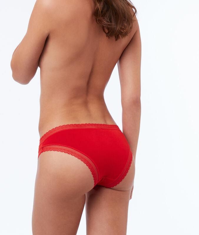 Broekje in zacht modaal, kanten boord rood.