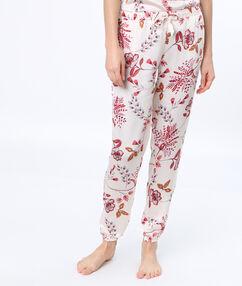 Pantalon imprimé fleuri blanc.