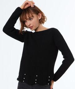 Pull tricot à perles noir.