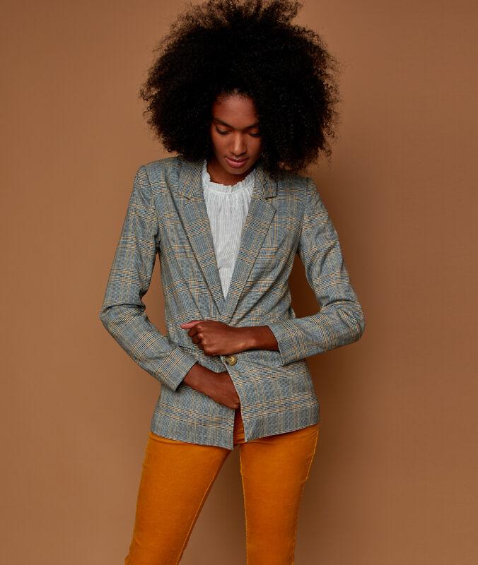 Veste de tailleur à carreaux gris.