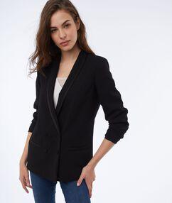 Veste col châle noir.