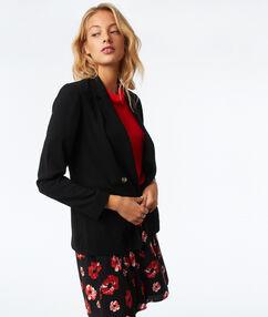 Veste de tailleur boutonnée noir.