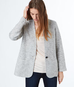 Getailleerde vest taupe clair.