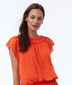 Uitlopende jurk oranje.