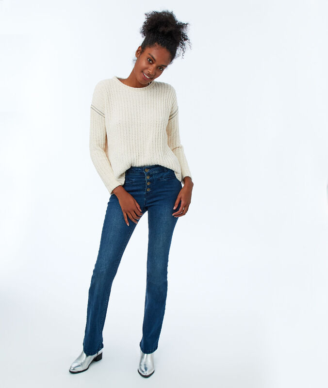 Jeans flare boutonné à l'avant bleu brut.