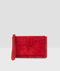 Porte-monnaie en croûte de cuir rouge.