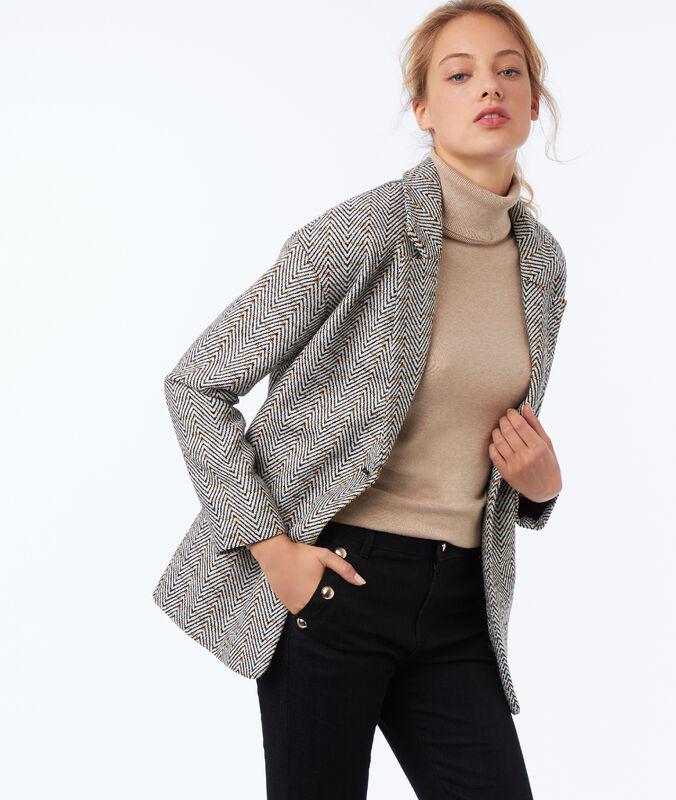 Manteau col tailleur motifs chevrons noir.