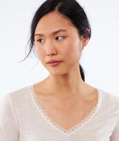 T-shirt met v-hals en kanten details beige.