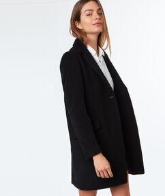 Manteau col tailleur en laine majoritaire noir.