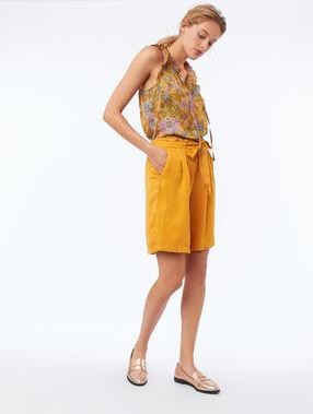 Top met tuniekkraag en bloemenprint geel.