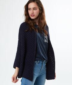 Gilet tricoté court bleu marine.