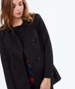 Trench court en coton noir.