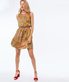 Mouwloze jurk met bloemenprint geel.